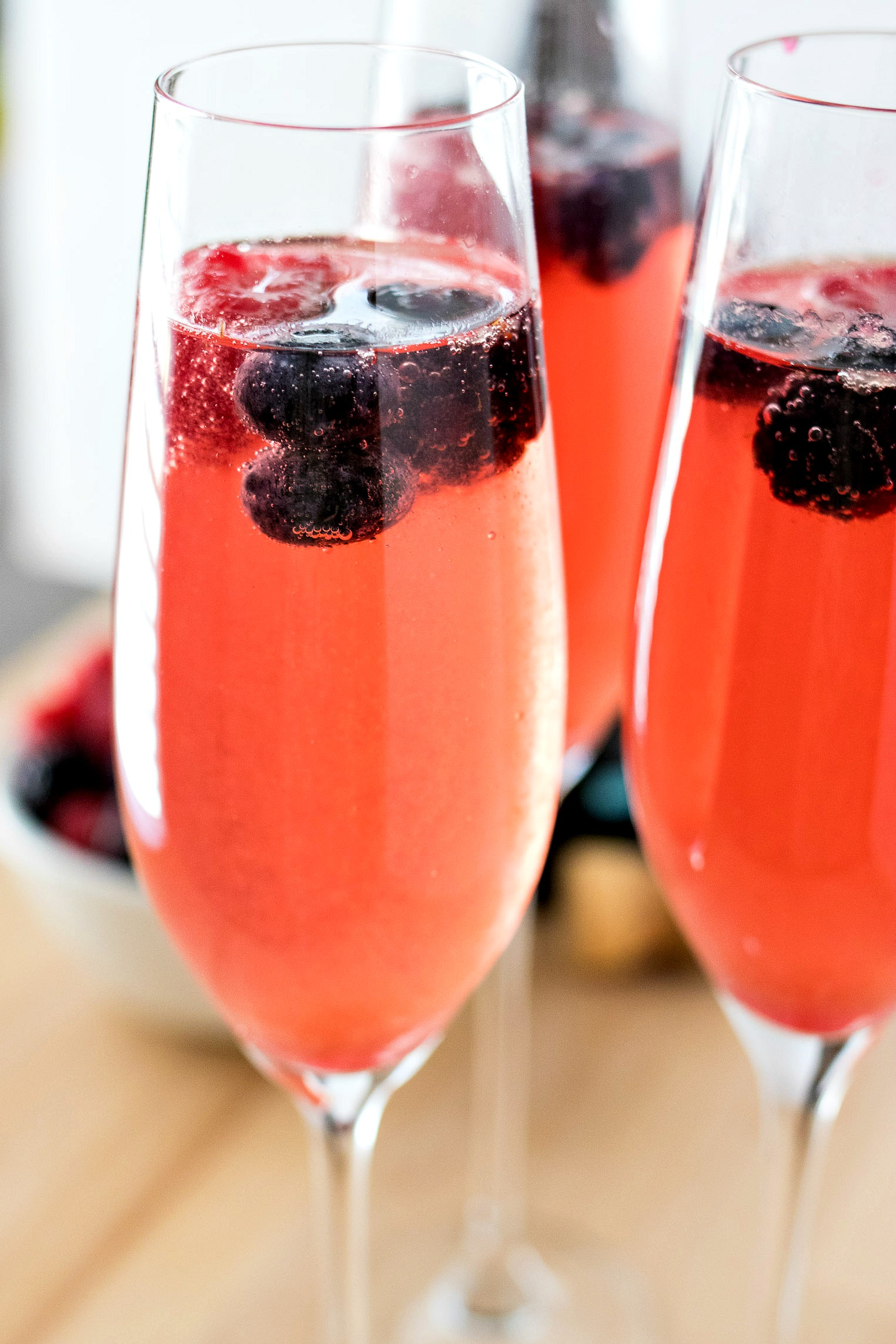 Berry Mimosas with whole blueberries, blackberries and raspberries