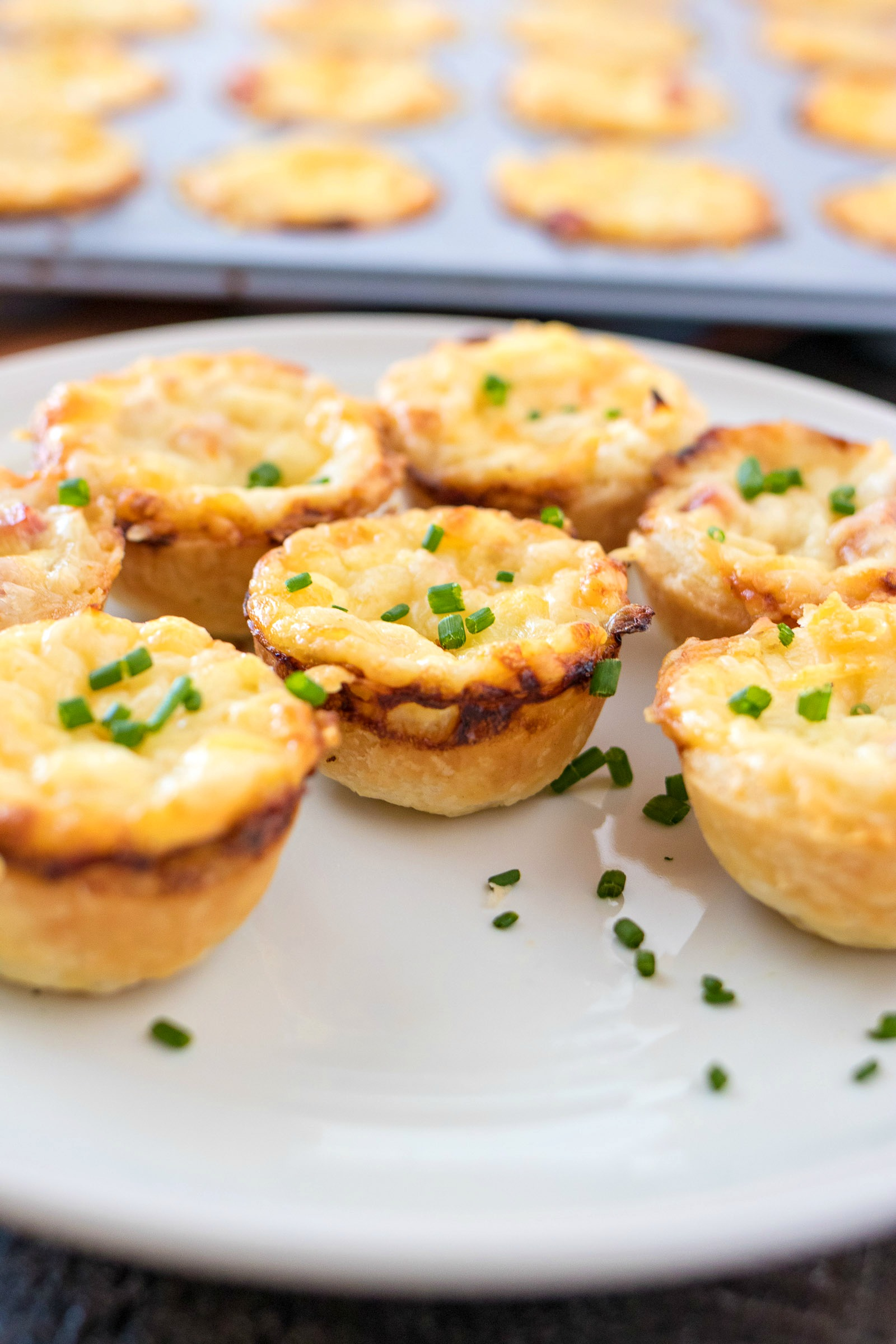 Closeup of Mini Ham and Cheese Quiche with Caramelized Onions on a plate