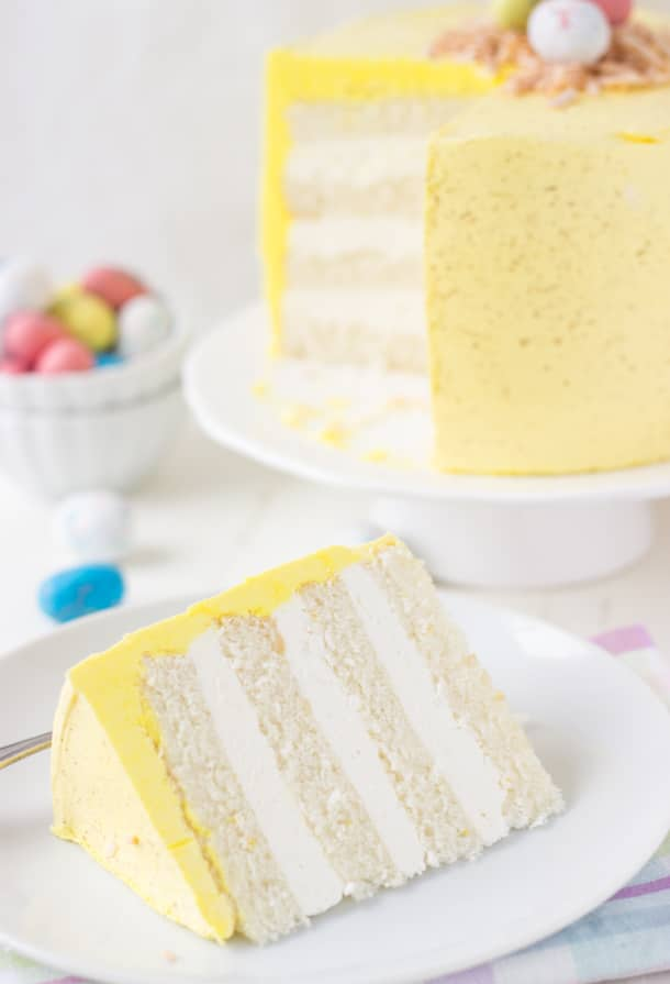 slice of Coconut Lemon Layer Cake (Easter Speckled Egg Cake) on a plate