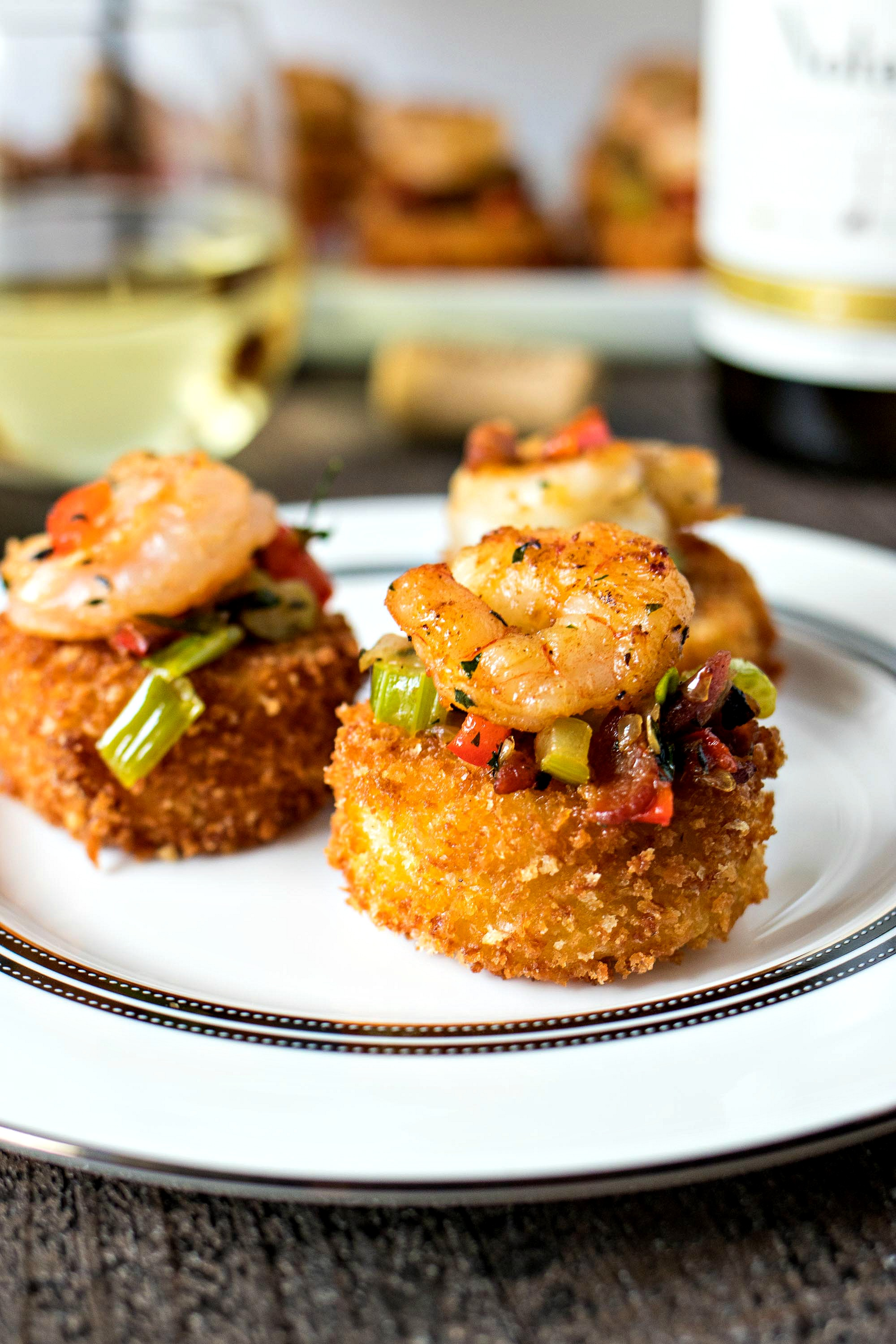 Shrimp & Grit Cake Bites - Ultra creamy grit patties are fried and served with a buttery sauteed shrimp and crispy bacon to create an appetizer that your guests will go crazy for. Pairs perfectly with the flavors of Chardonnay wine!