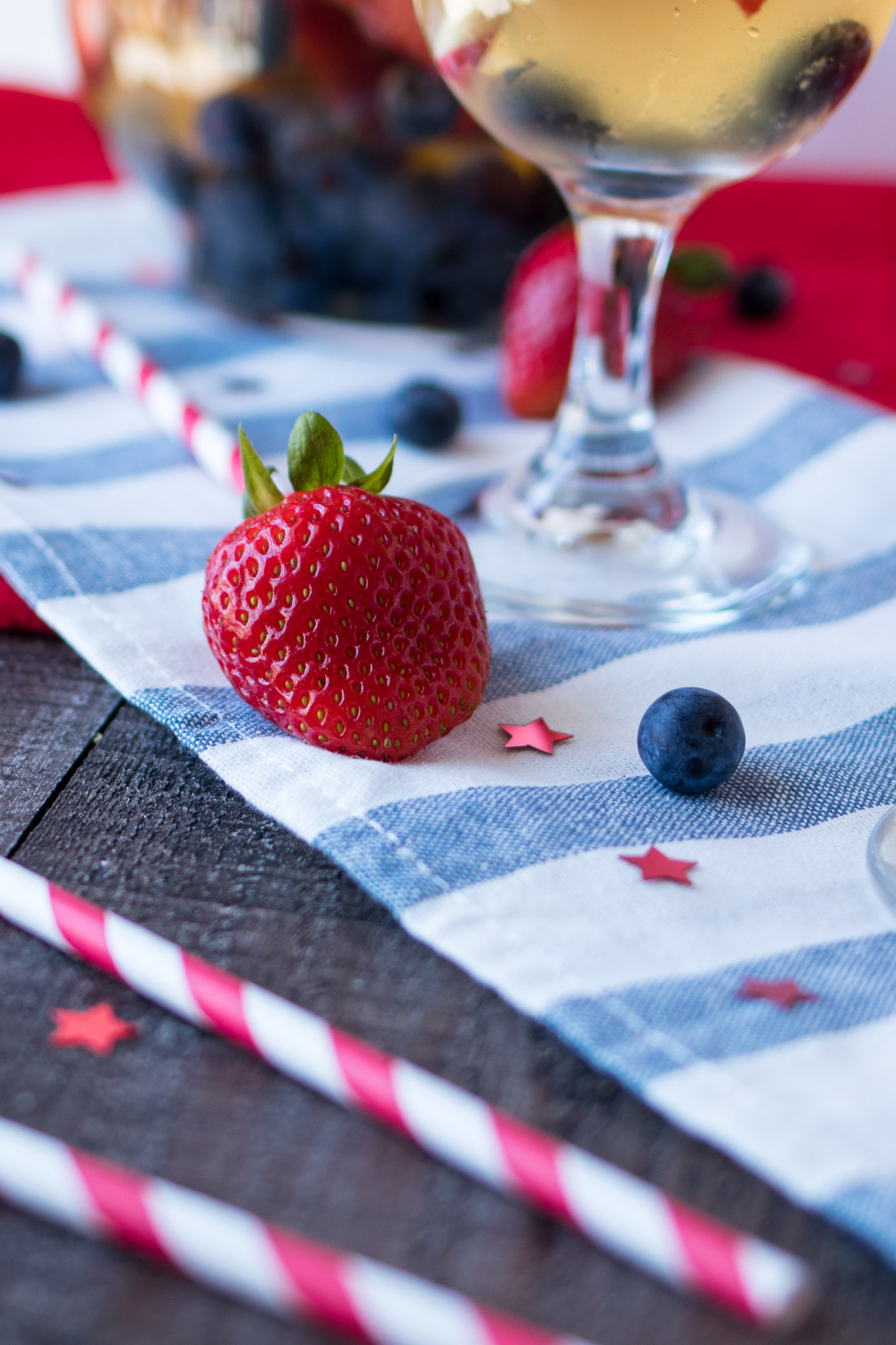 Strawberry and blueberry on a blue striped tablecloth