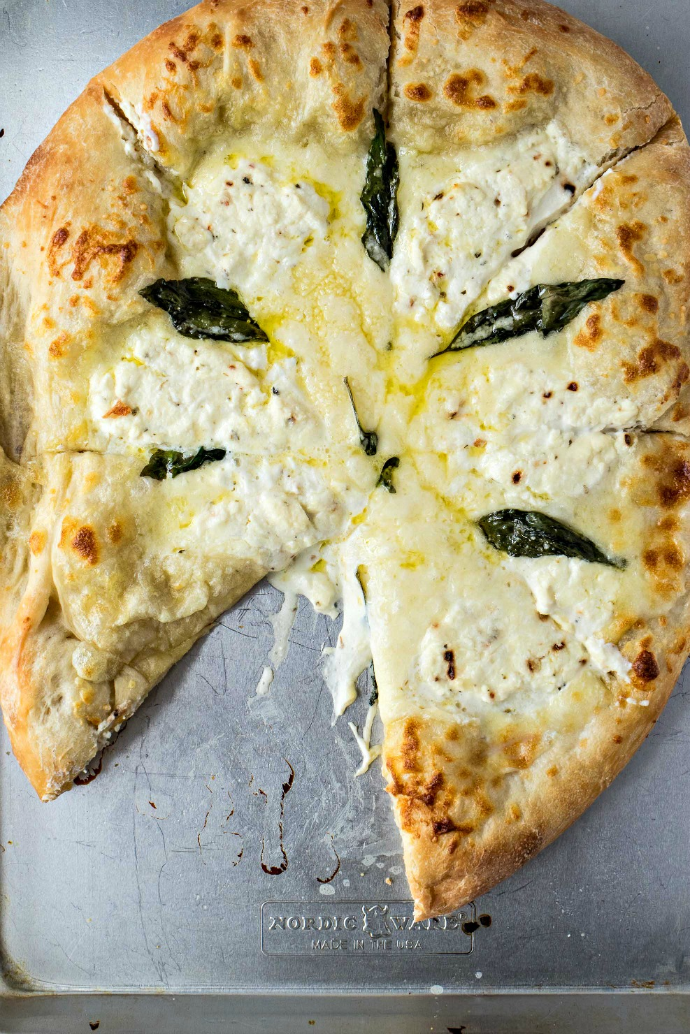 The Best Pizza Bianca with a slice missing