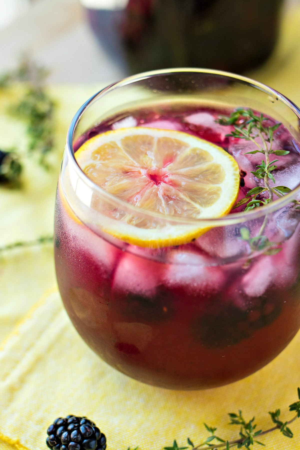 Blackberry Lemon Vodka Punch - A refreshing spiked punch made with fresh lemon juice, muddled blackberries, and a homemade blackberry & thyme infused vodka. The perfect drink to enjoy any time of year!