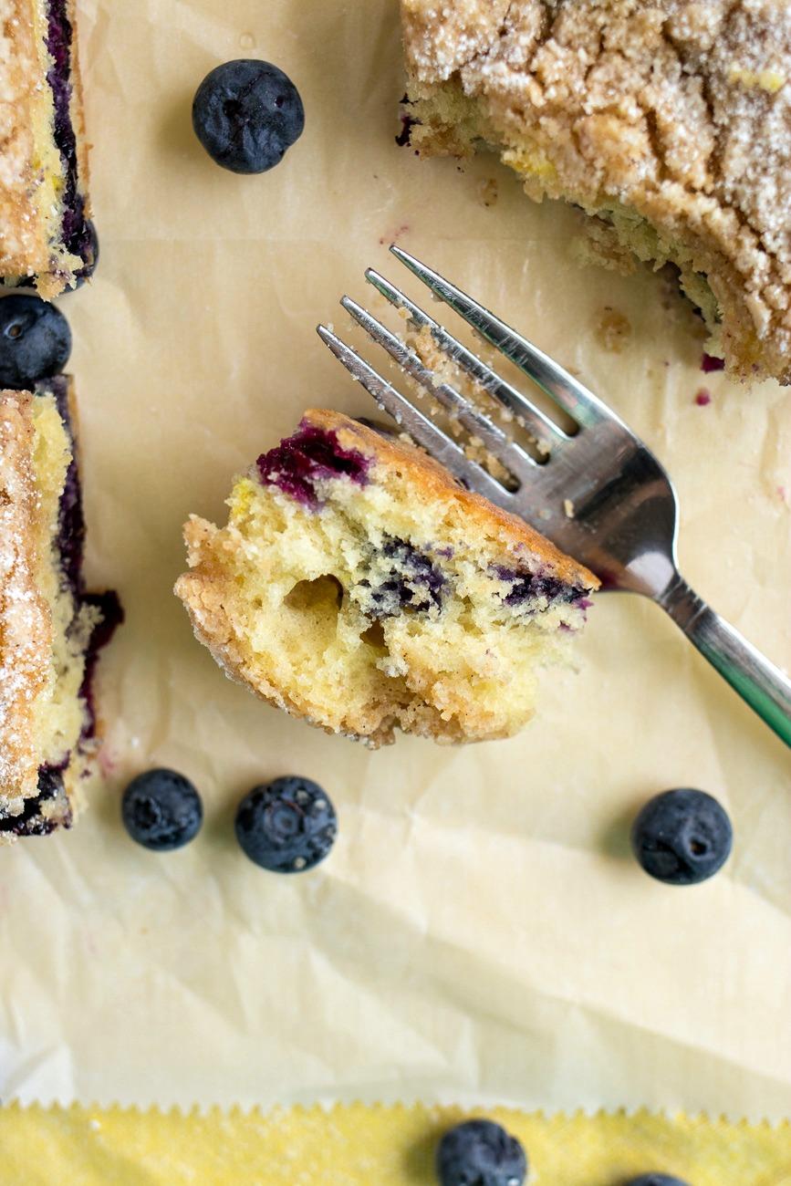 Fork cutting Blueberry Coffee Cake
