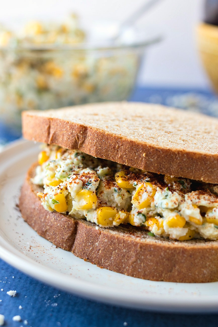 Mexican Street Corn Chicken Salad - All the flavors of Mexican Street Corn are mixed with chopped chicken breast and Greek yogurt to make a flavorful chicken salad that can be eaten as a sandwich or by itself.