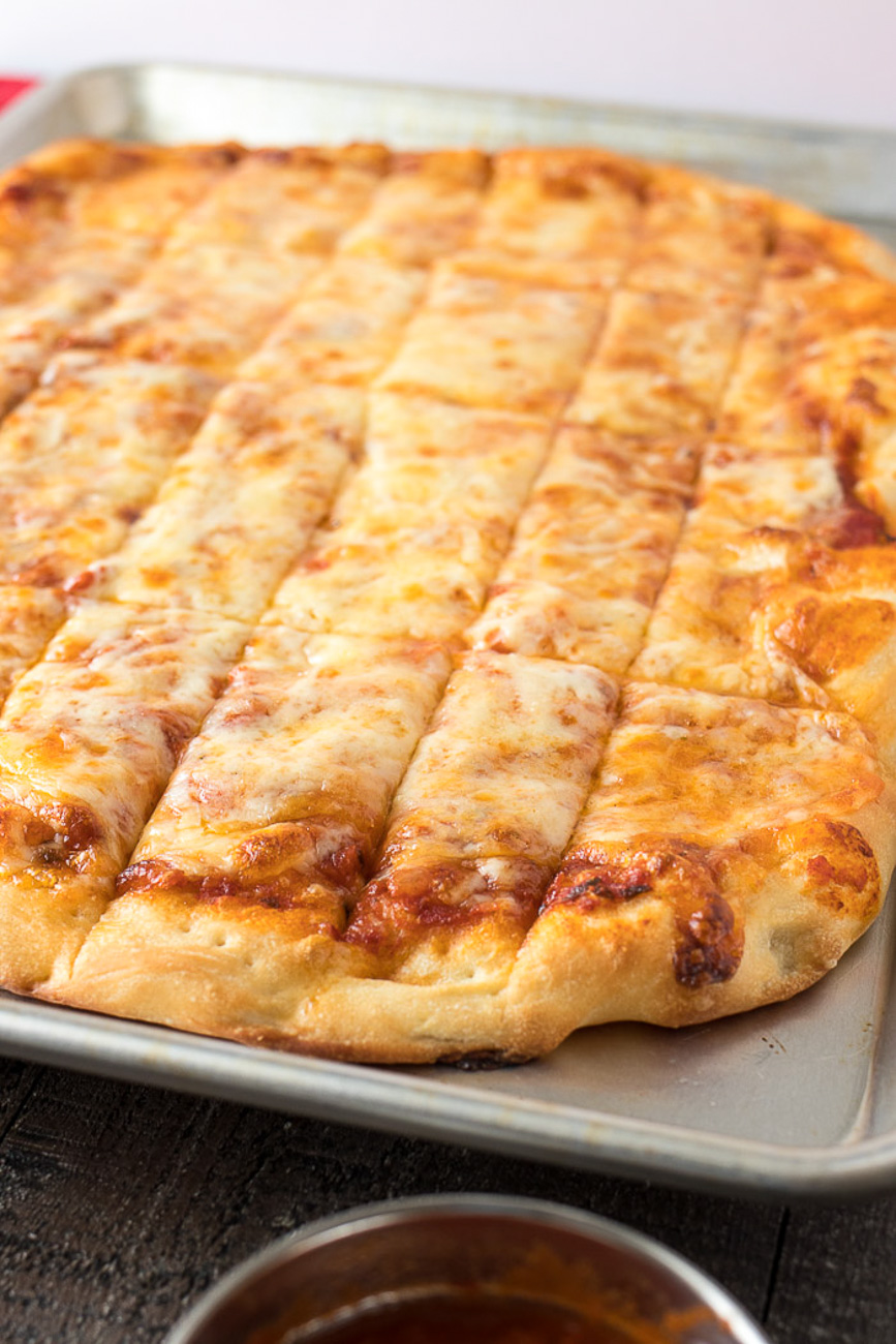 Four Cheese Pizza Dunkers cut into strips on a tray