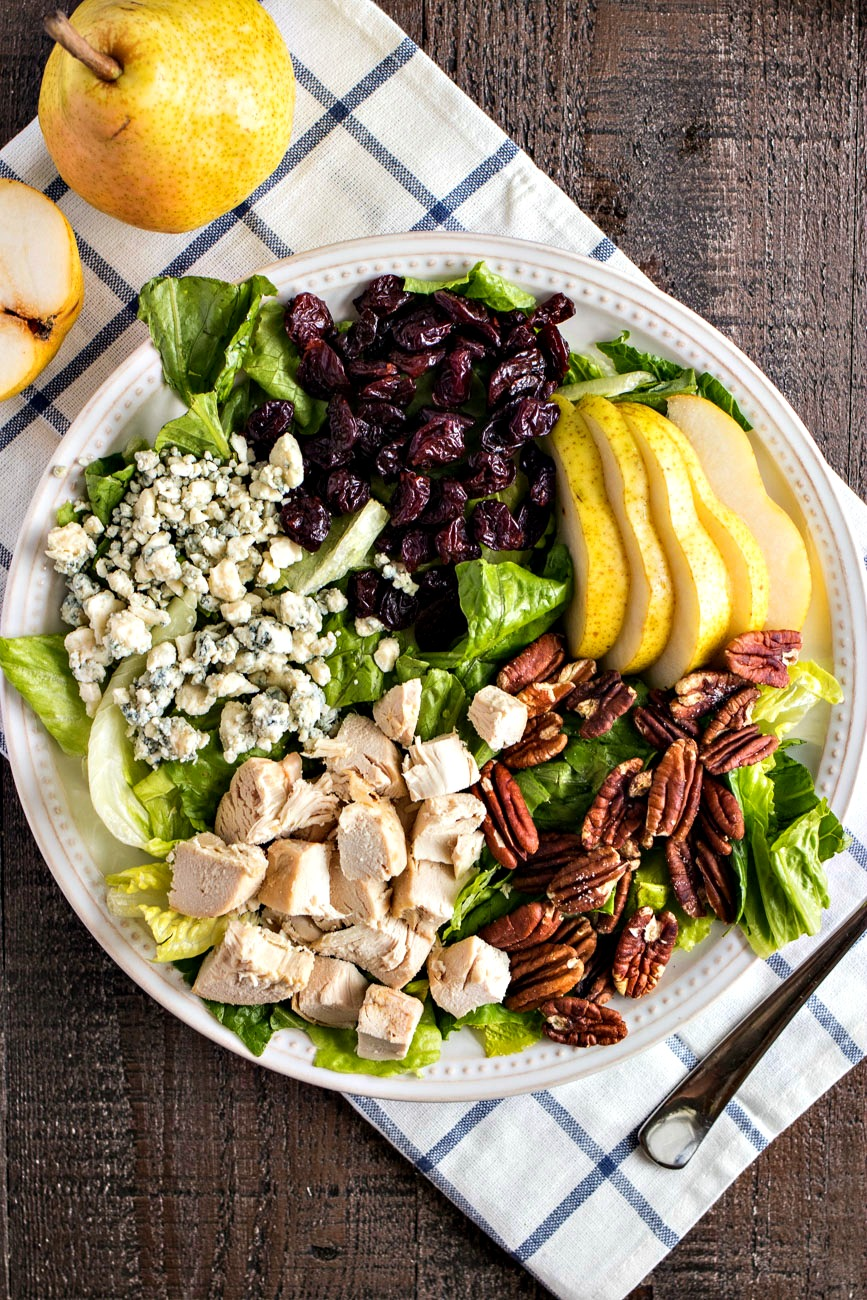 Orchard Harvest Salad (Panera Copycat) - Chopped romaine lettuce tossed with sliced pears, dried cherries, pecans, gorgonzola cheese, diced chicken and homemade cherry balsamic vinaigrette. Copycat recipe of the seasonal Orchard Harvest salad from Panera Bread.