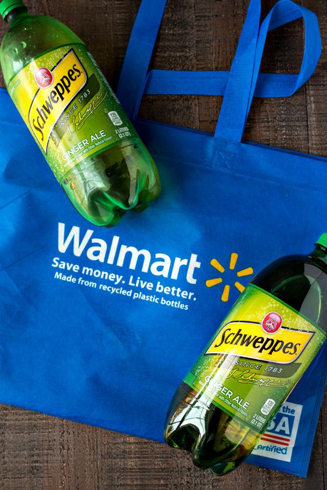 Two bottles of Schweppes ginger ale on a walmart bag