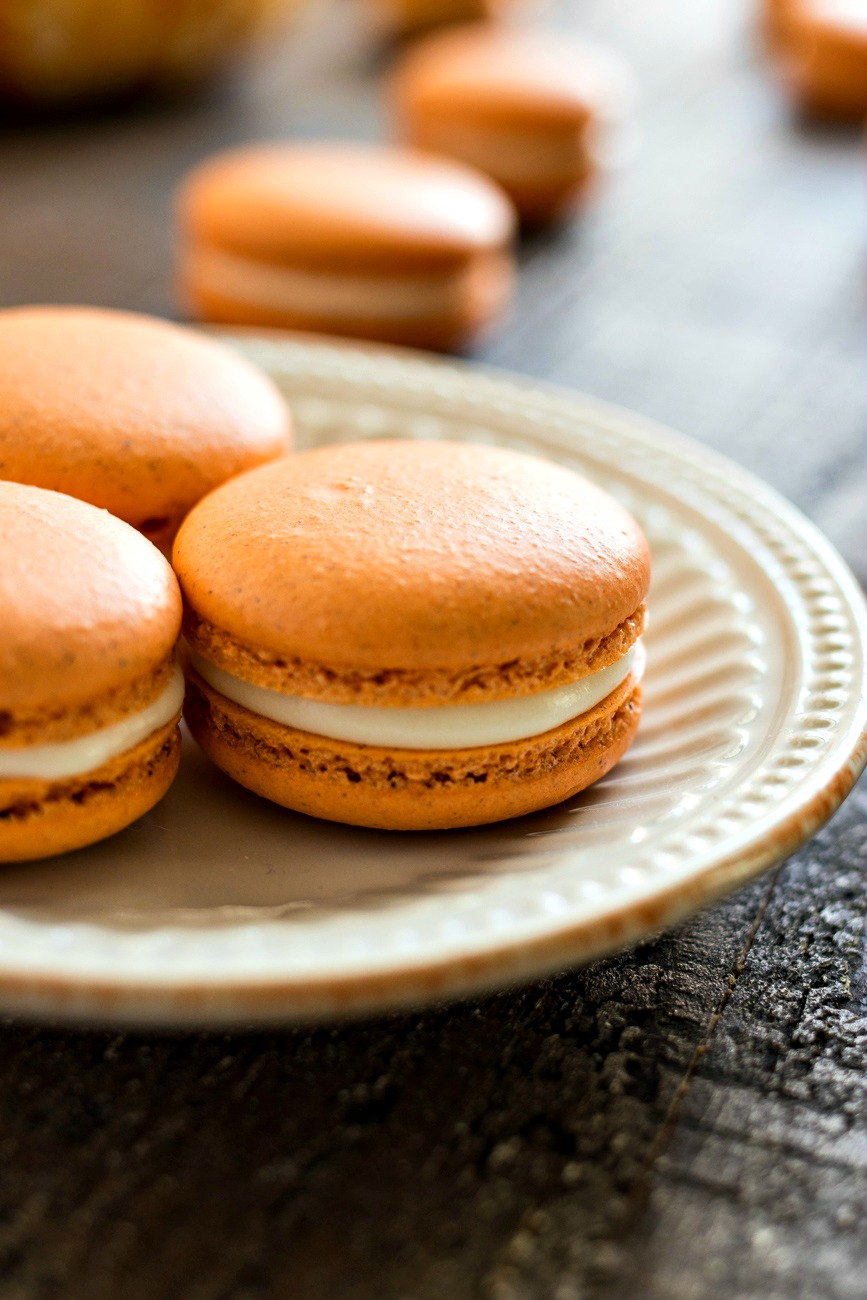 Pumpkin Cheesecake Macarons on a plate