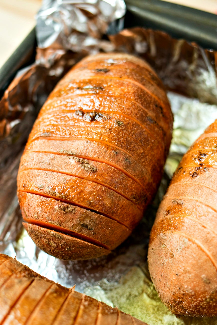 Sage & Browned Butter Hasselback Sweet Potatoes after being buttered