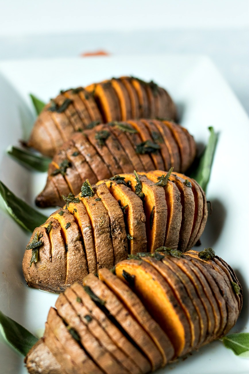 Sage & Browned Butter Hasselback Sweet Potatoes with sage on top