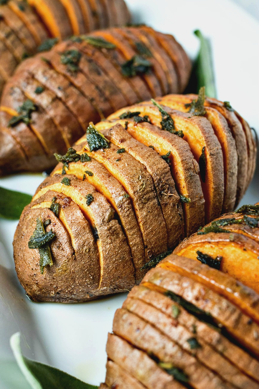 Closeup of Sage & Browned Butter Hasselback Sweet Potatoes