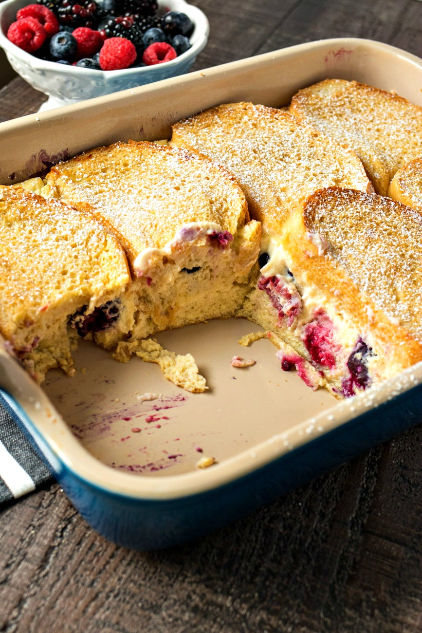 Berries & Cream Stuffed French Toast Casserole after being cut showing the berries between the french toast bread pieces