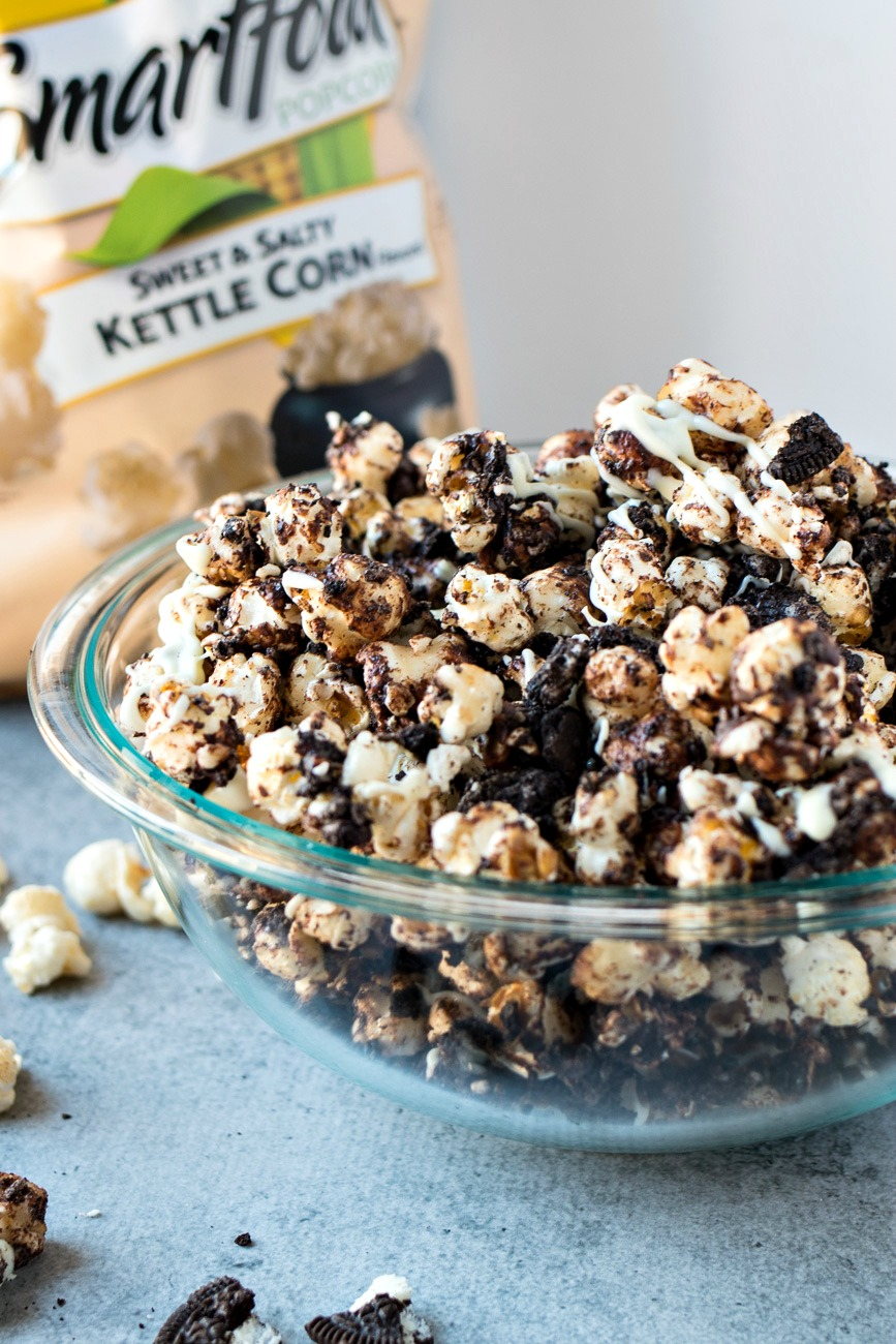 Cookies & Cream Popcorn - SMARTFOOD® Sweet & Salty Kettle Corn is coated with crushed chocolate cookies and drizzled with semi-sweet chocolate and white chocolate to make a sweet & salty snack for all your football parties this season!