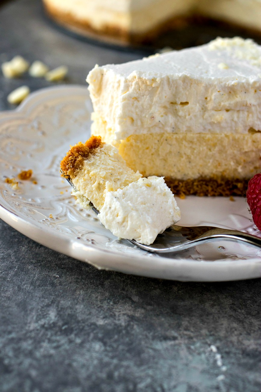 Vanilla Bean Cheesecake with a piece of it on a fork