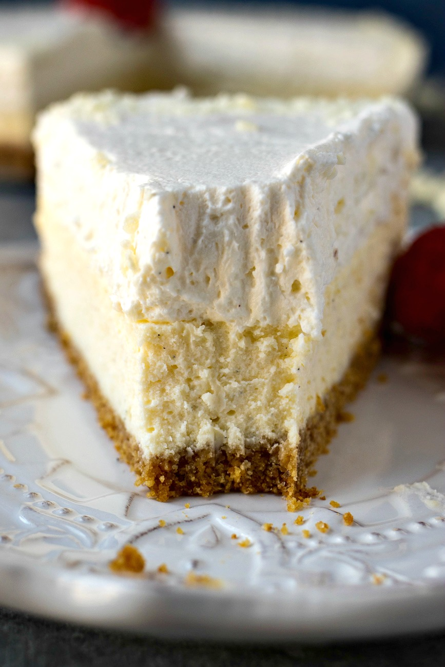 Piece of Vanilla Bean Cheesecake with a piece missing
