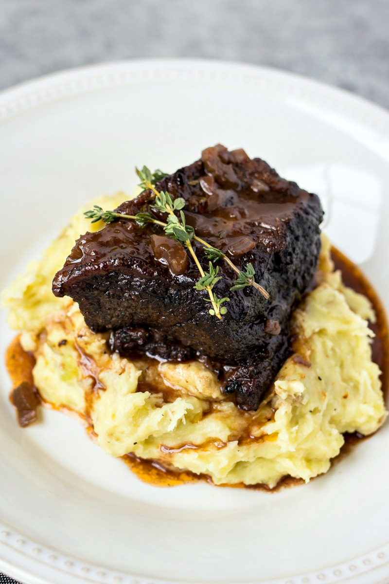 Slow Cooker Short Ribs on top of mashed potatoes