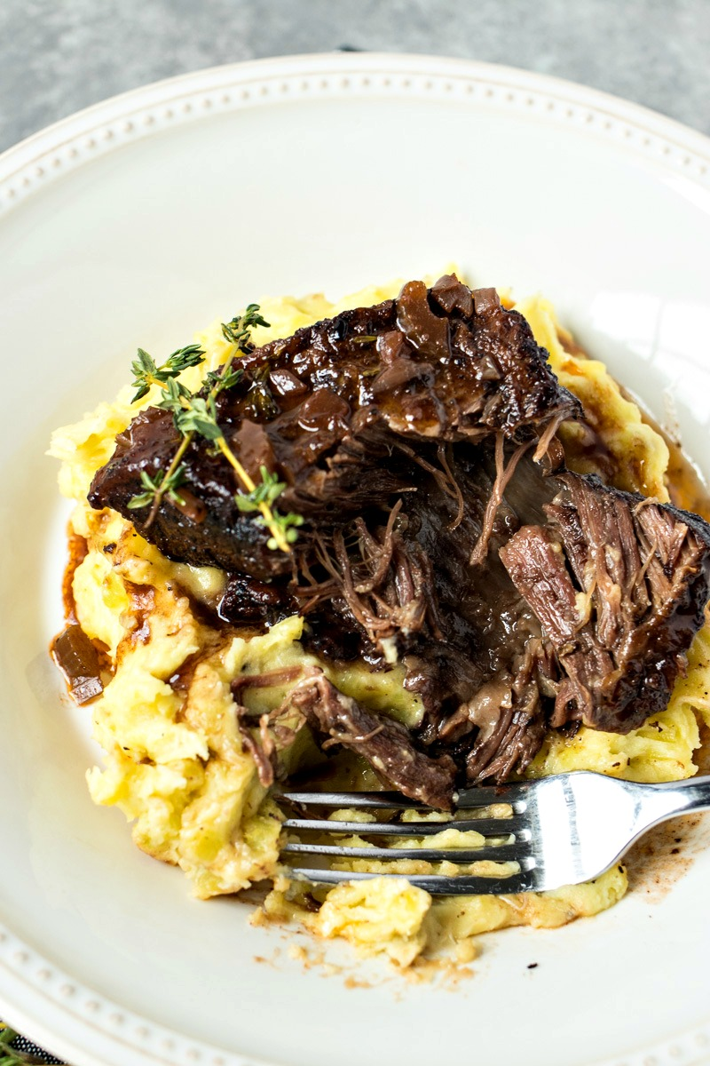 Slow Cooker Short Ribs on a plate with mashed potatoes