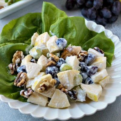 Healthy Waldorf Salad - This classic salad of apples, grapes, walnuts, and celery is given a healthy makeover with the substitution of mayo with Greek yogurt.