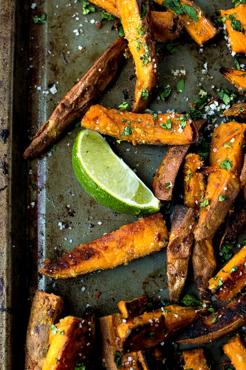 Cilantro Lime Sweet Potato Fries with a lime wedge