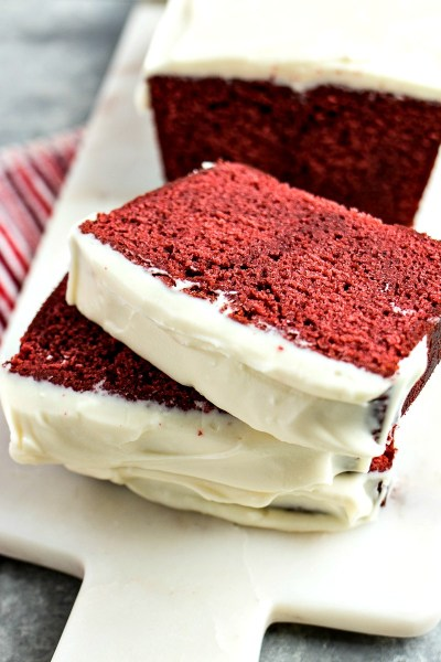 Red Velvet Loaf - Ultra-moist red velvet loaf cake topped with fluffy cream cheese frosting