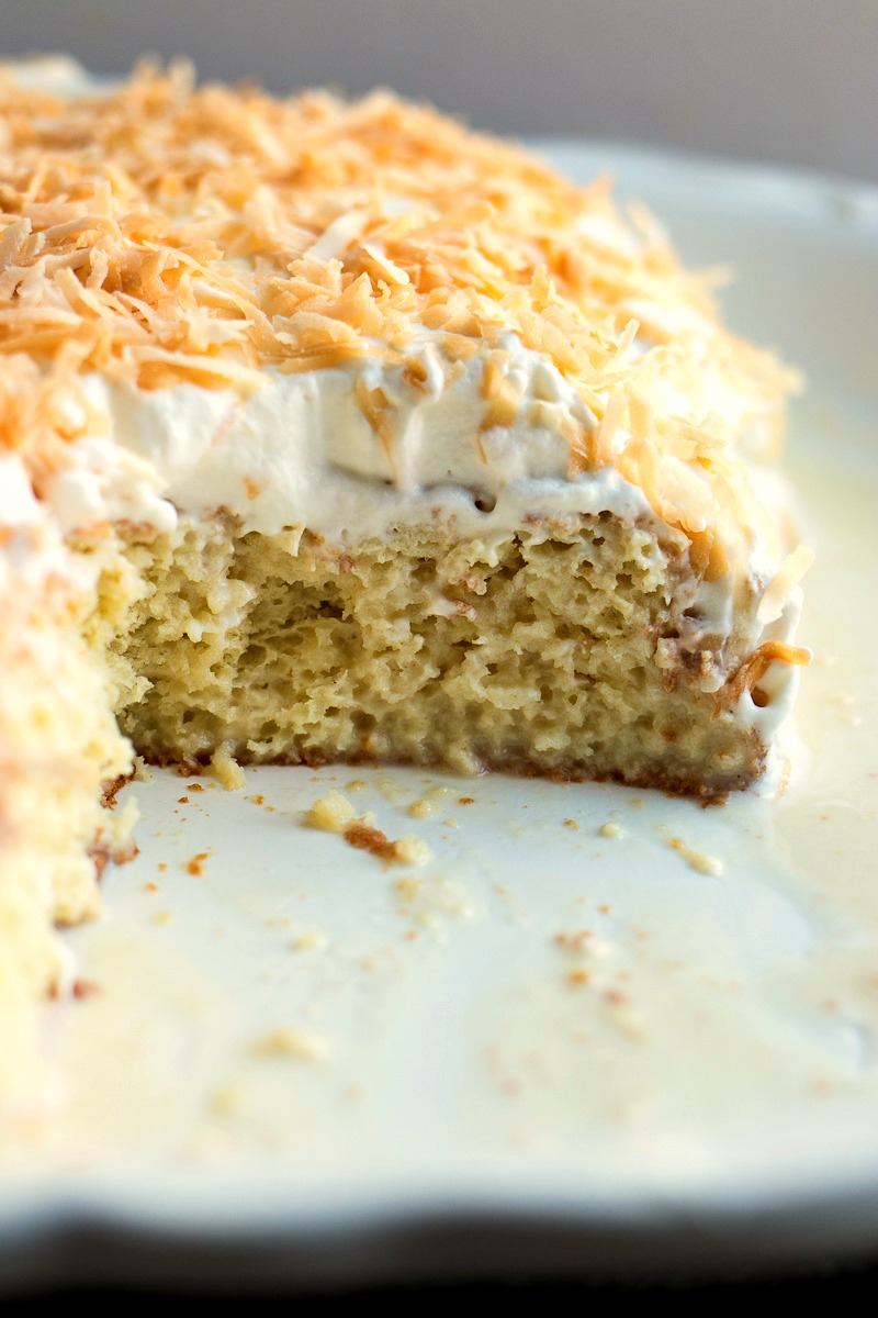 Pan of Coconut Tres Leches with toasted coconut on top