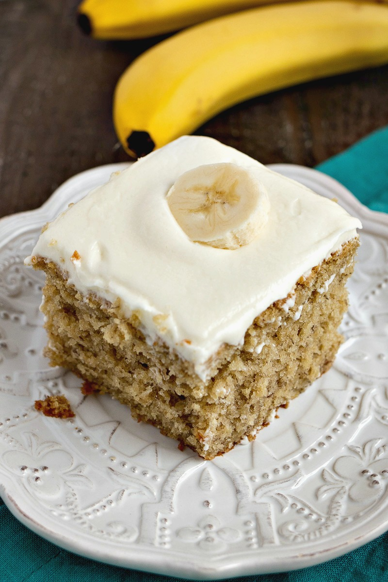 Piece of Easy Banana Cake on a plate in front of bananas