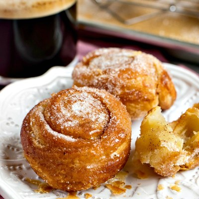 Vanilla Bean Morning Buns - Puff pastry rolled into a bun with vanilla bean sugar, a hint of cinnamon, and baked until puffed and golden brown.
