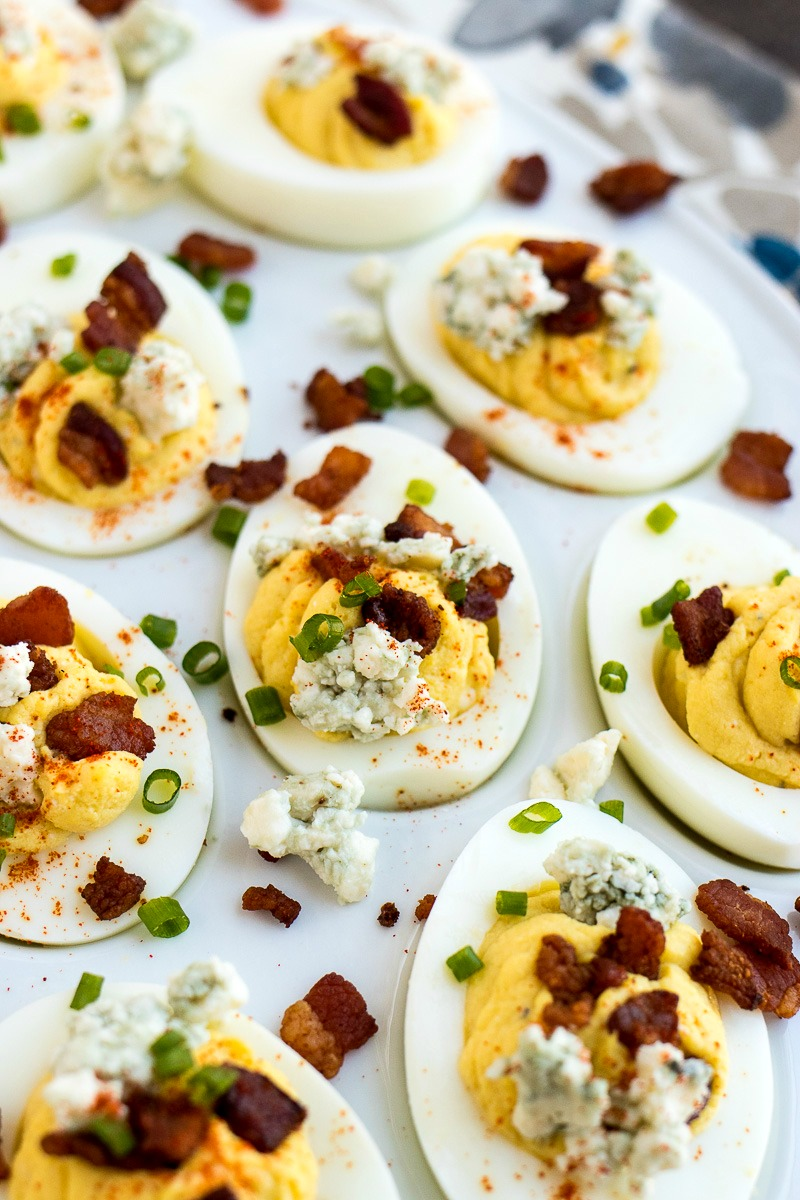 Tray of Bacon & Blue Cheese Deviled Eggs topped with bacon and blue cheese