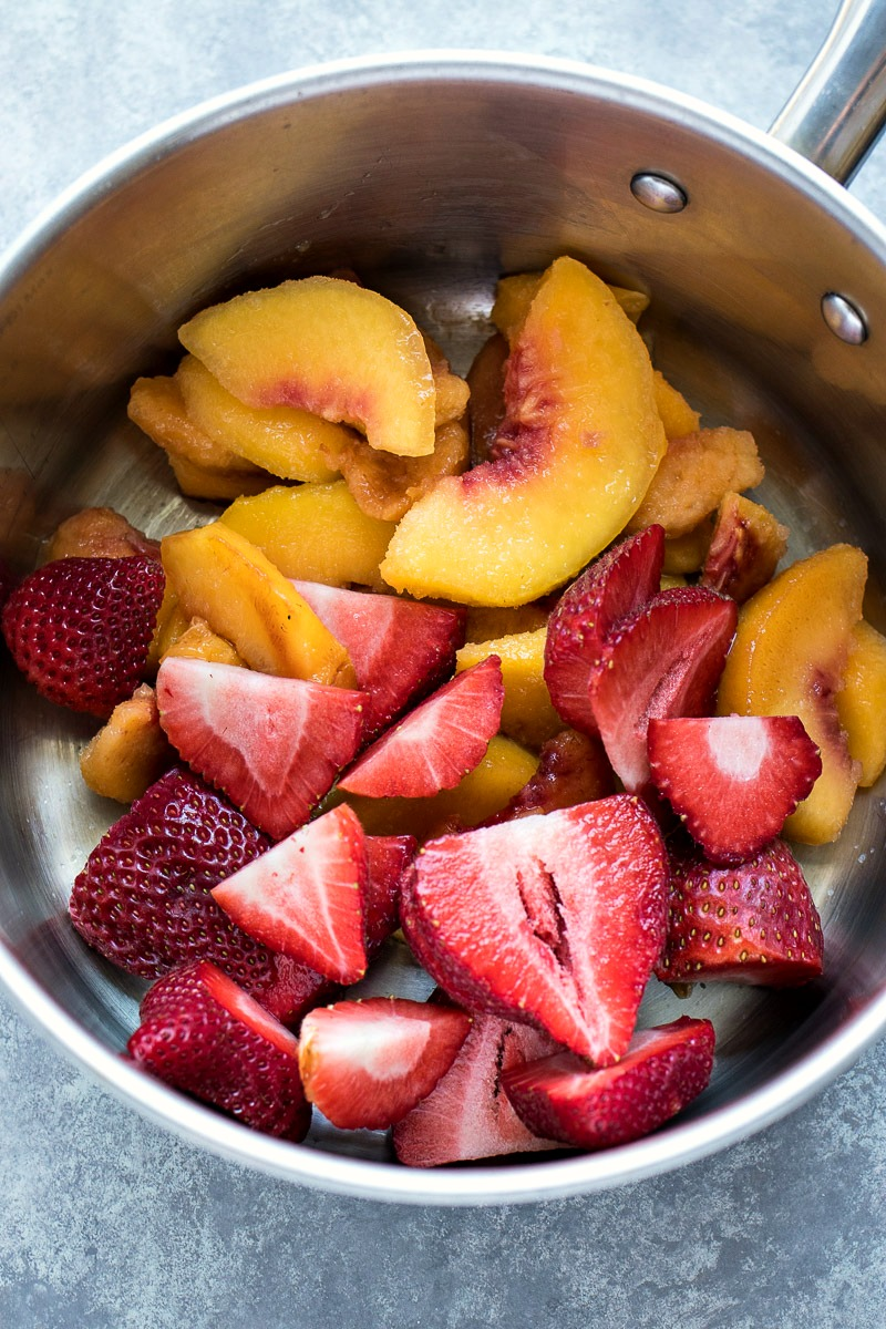 Pot of sliced strawberries and sliced peaches