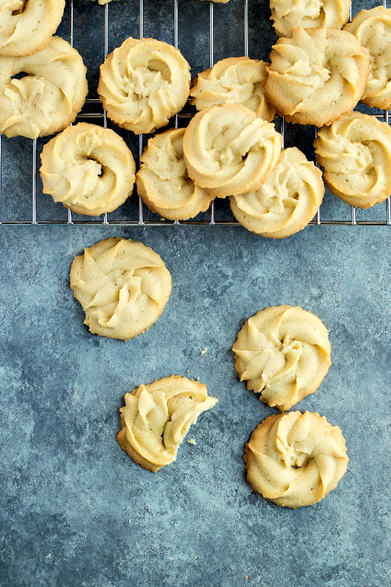 Danish Butter Cookies on a cooling rack and counter