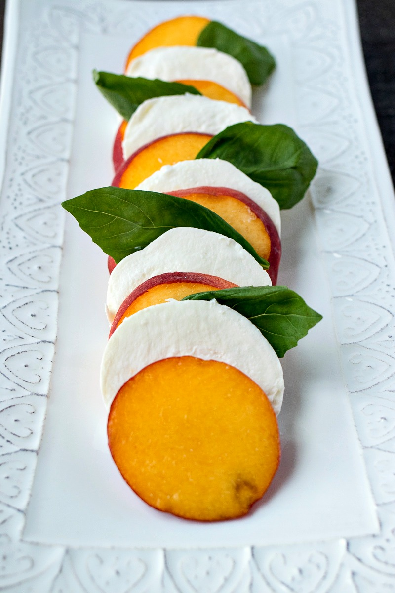 Peach Caprese Salad before being drizzled with oil and balsamic glaze