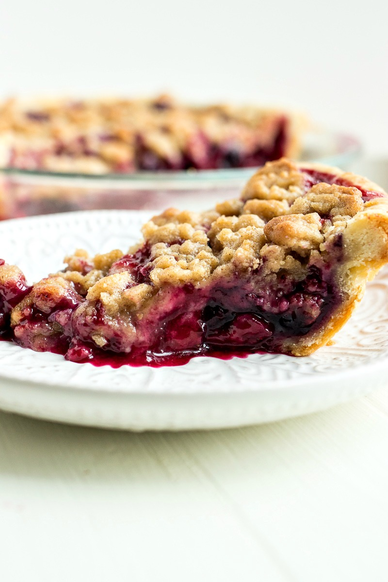 Slice of Berry Crumble Pie on a white plate