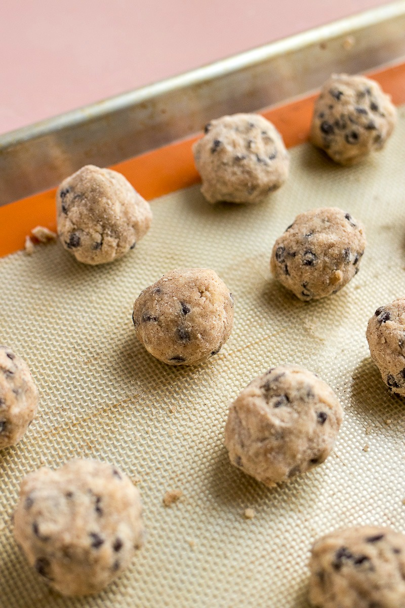 Cinnamon Chocolate Chip Snowballs dough in balls on a cookie sheet
