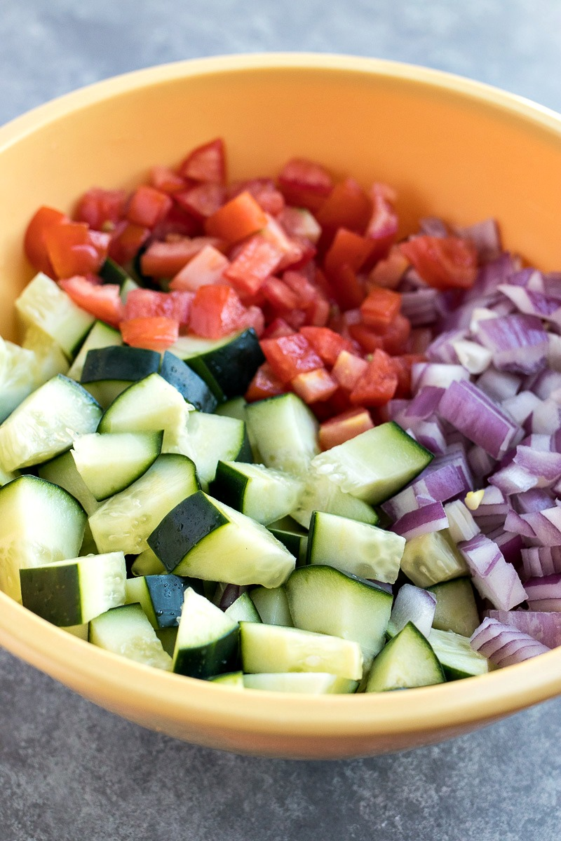 Bowl of sliced tomatoes, onions and cucumbers