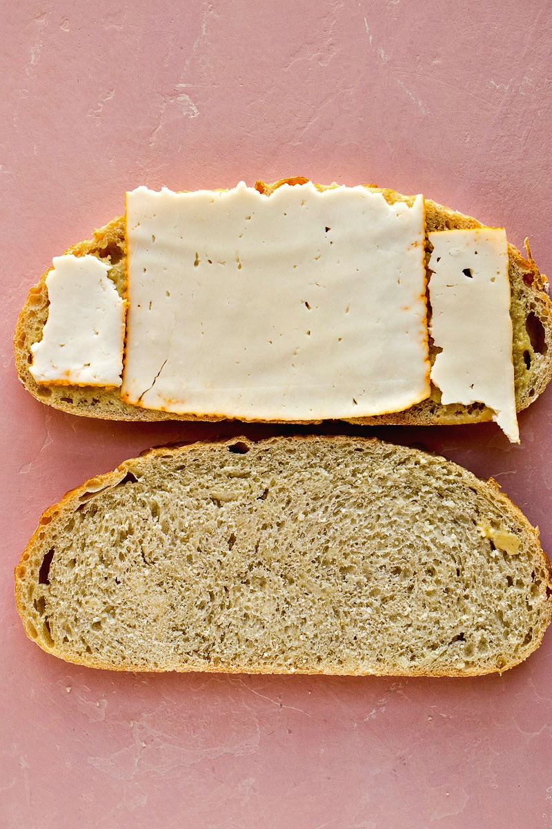 Bread with turkey slices over the layer of dijon honey mustard