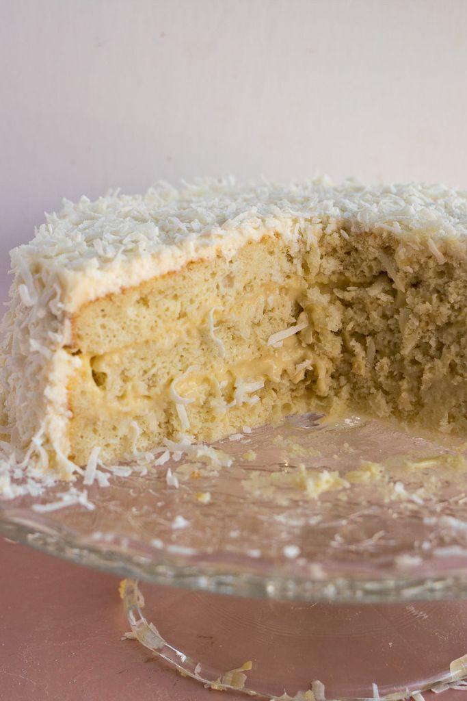 Coconut Cream Cake cut in half to show the layers of coconut cream inside