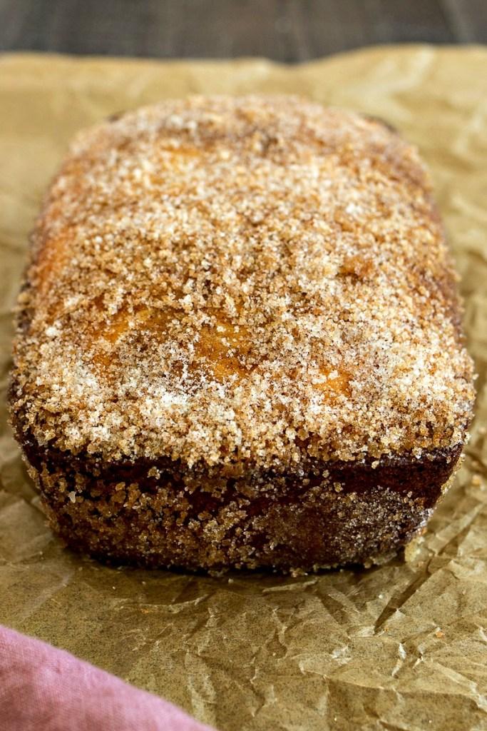 Cinnamon Swirl Doughnut Loaf coated in cinnamon sugar
