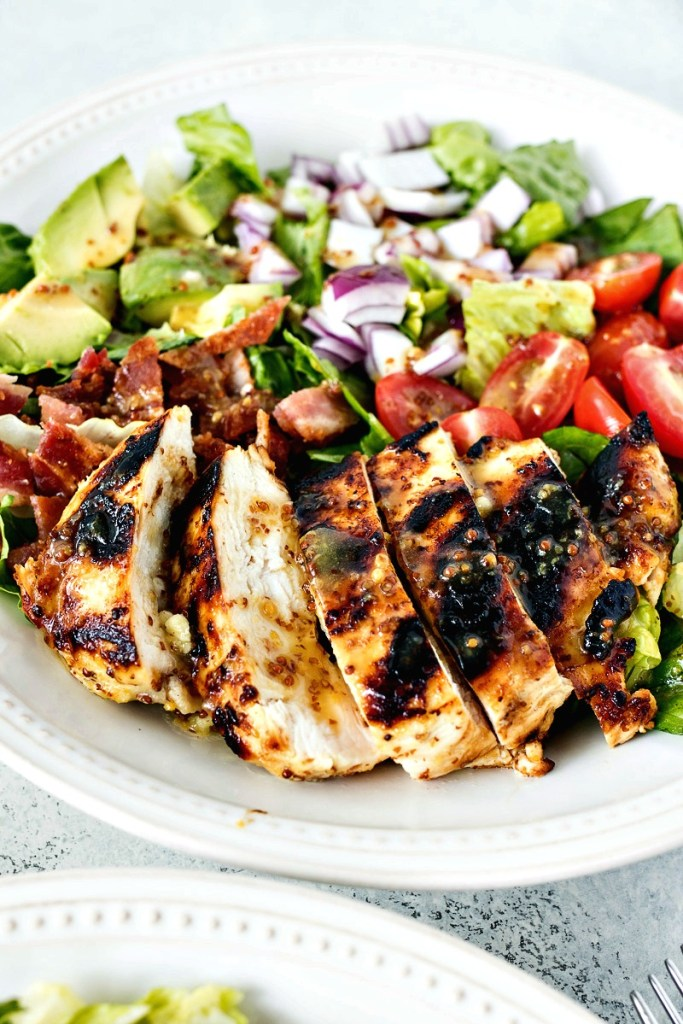Honey Mustard Chopped Salad with slices of marinated chicken