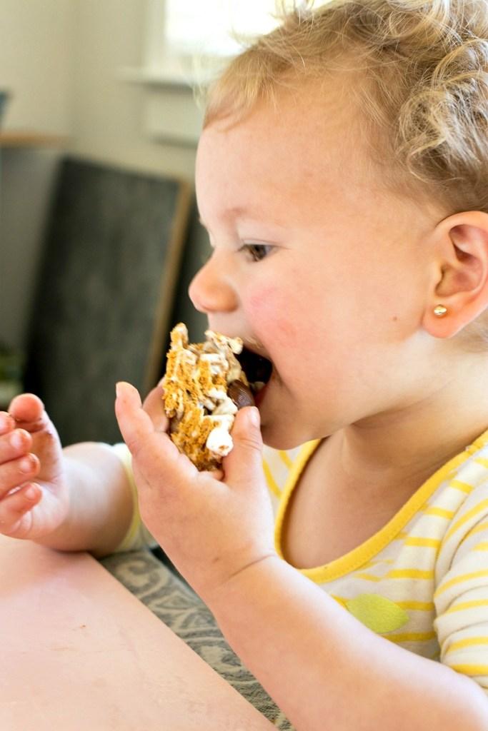 Little girl eating a Crispy S'mores Bar