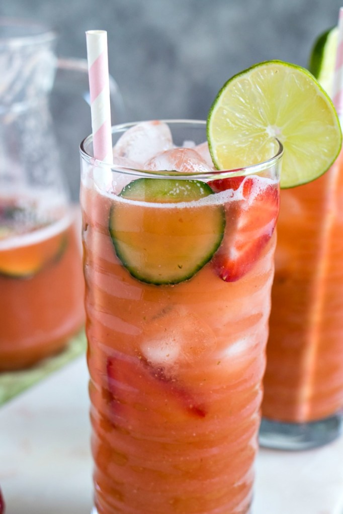 Tall glass of Strawberry Cucumber Limeade with strawberry and cucumber slices