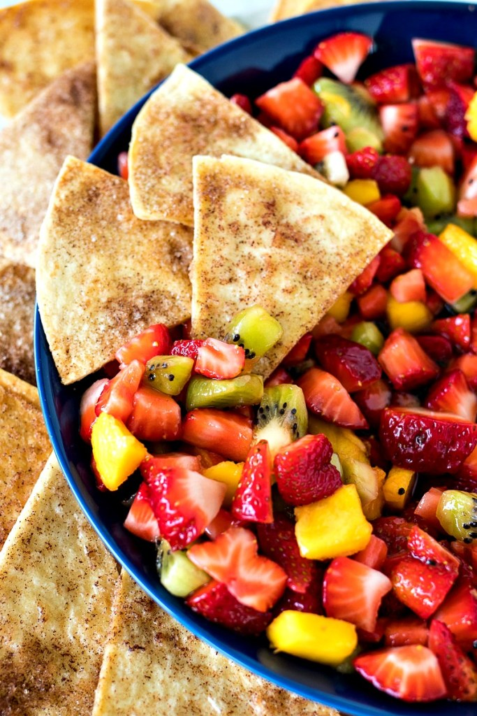 Cinnamon chips dipped into the fruit salad