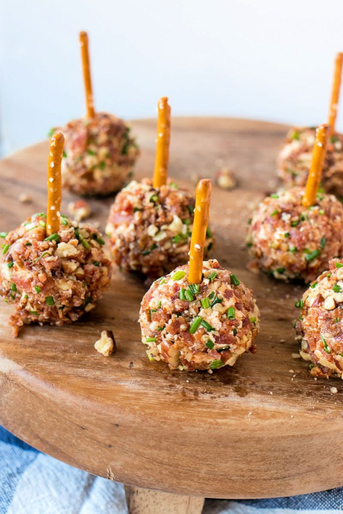 Plate of Cheeseball Bites with a pretzel sticking out of the top