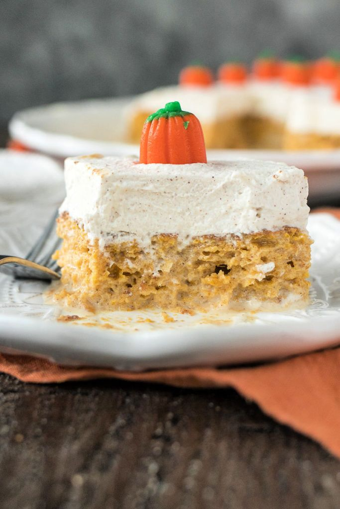 Piece of Pumpkin Tres Leches on a plate topped with a candy pumpkin