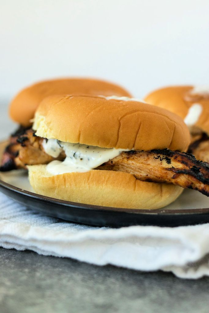 picture of my favorite grilled chicken sandwich on plate with ranch dressing running down the side