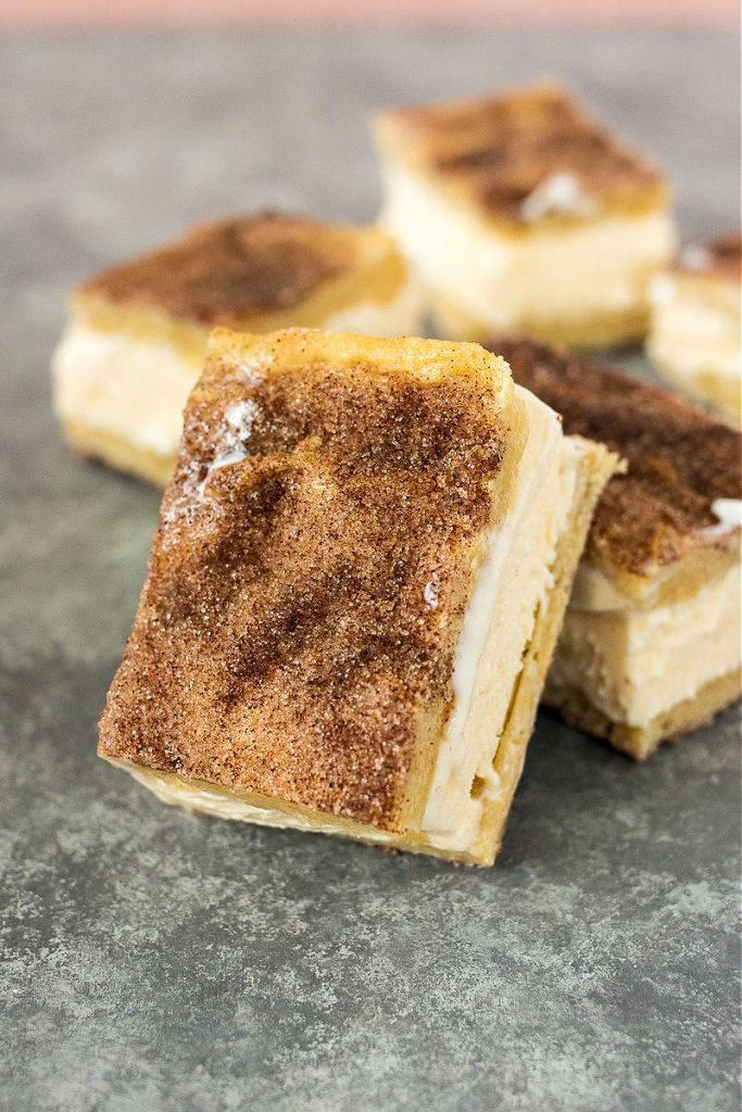 photo of snickerdoodle ice cream bar leaning up against another sandwich so the cinnamon sugar top is showing