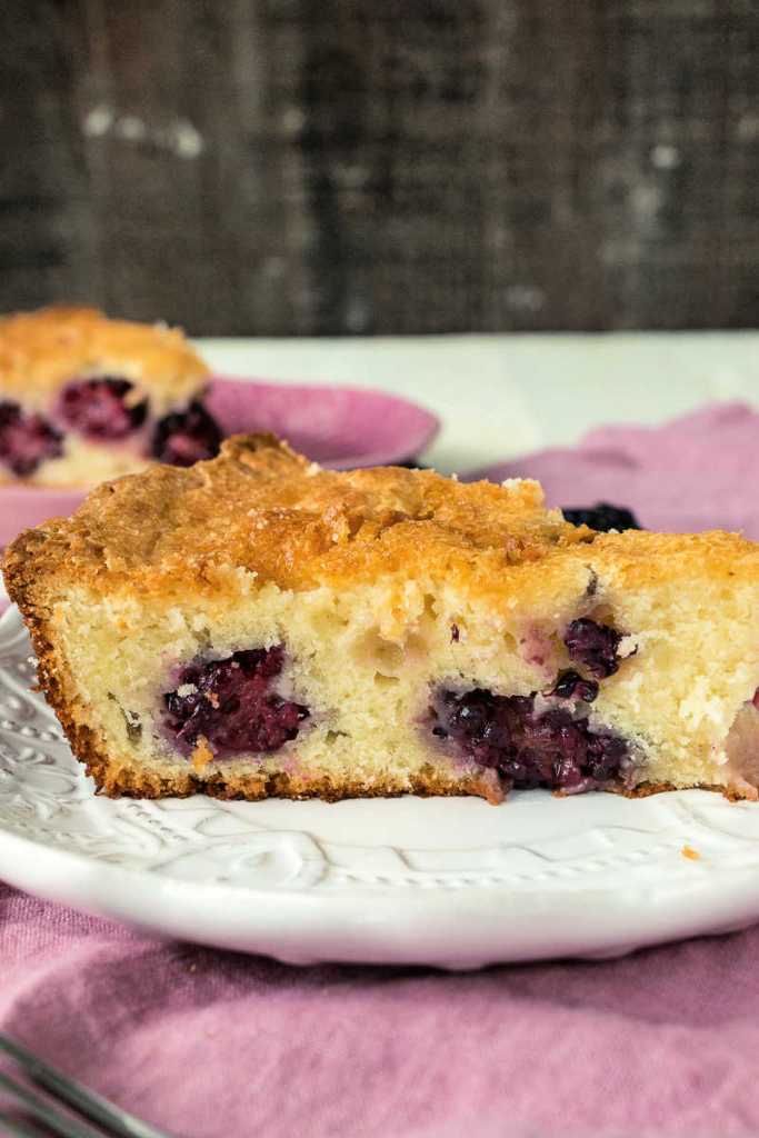 close up of slice of blackberry skillet pound cake shot from the side