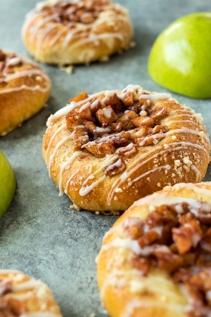 photo of cinnamon apple kolaches with granny smith apples in the background