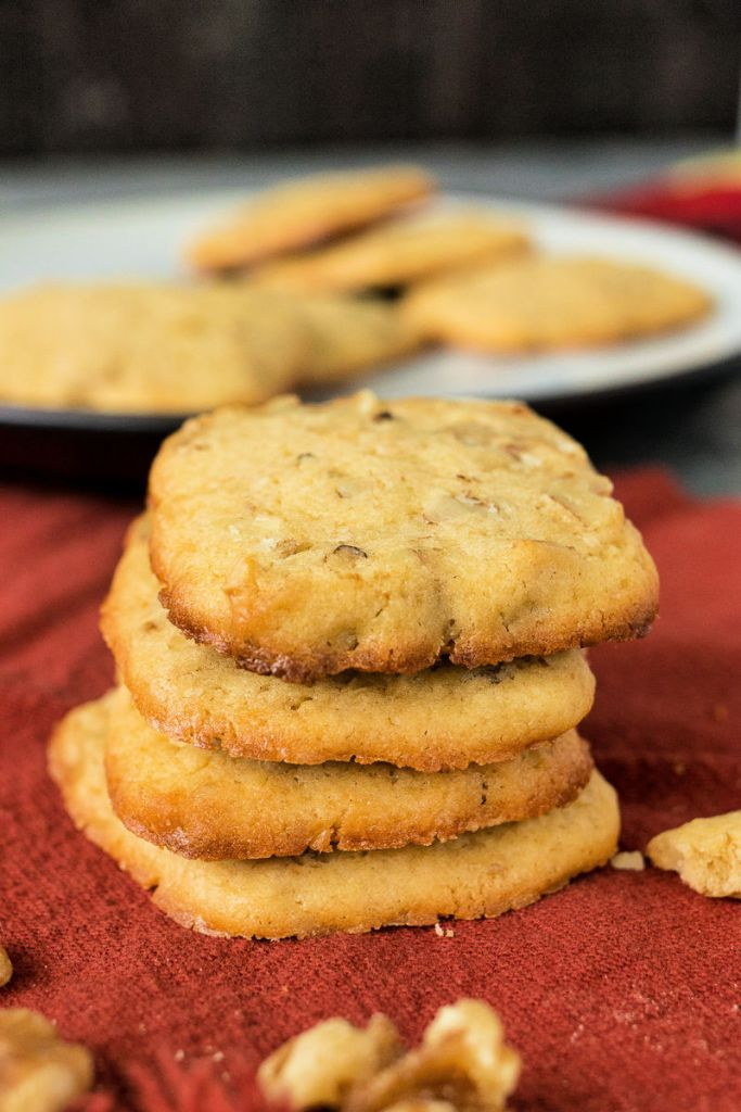 photo of stacked maple walnut  cookies on a red orange napkin