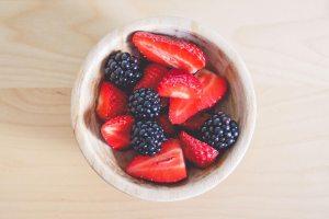fresh strawberries and blackberries in little bowl